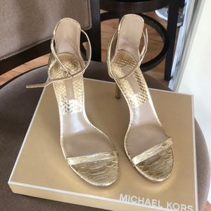 Michael Kors gold metallic embossed leather heels.